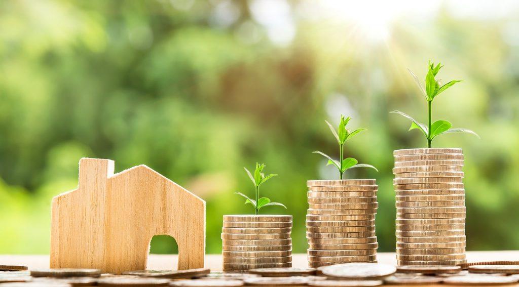 Immobilienbewertung, Haus mit Geld, Heinsen Immobilien